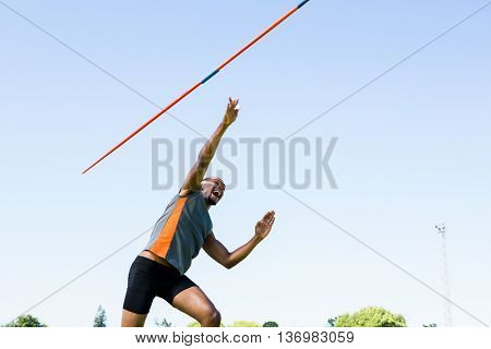Athlete throwing a javelin in the stadium