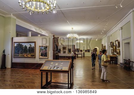 VELIKY NOVGOROD RUSSIA-JULY 1 2016. Unidentified museum visitors look exhibits in the showroom of Art Museum of Veliky Novgorod