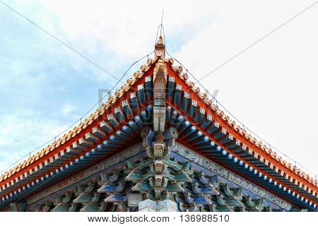 Original stylish old Chinese palace roof. urban background