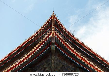 Beautiful Chinese roof. urban background. Blue sky