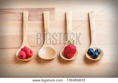 still life of strawberries with berries and raspberries isolated in the foreground