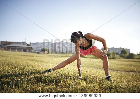 Young sports woman stretching and preparing to run.