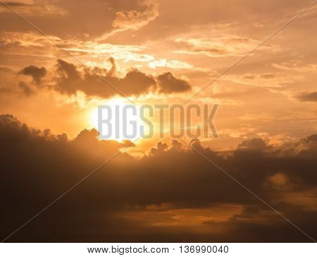 Orange yellow vibrant blazing colourful clouded sunset