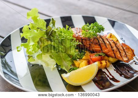 Grilled Salmon with lemon and mango. Selective focus