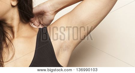armpit axillary space black hair woman body care isolated on white background black top studio shot figure body part