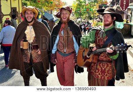 Mount Hope Pennsylvania - October 17 2015: A trio of musicians strolling along a street at the annual Pennsylvania Renaissance Faire