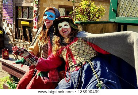 Mount Hope Pennsylvania - October 17 2015: Two masked women celebrating in their fancy costumes at the annual Pennsylvania Renaissance Faire