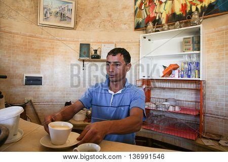 Man Serving Coffee At Dar Ayed