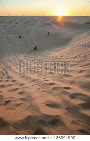 The dunes of Sahara desert at sunset in Ong JemelTozeurTunisia.