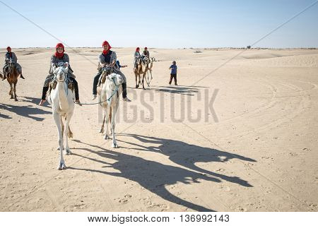 Tourists Riding Camels