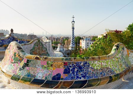 cityscape of Barcelona with bench of park Guell at summer day, Spain