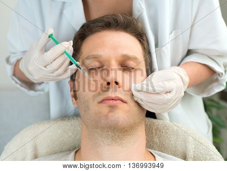 Handsome Man Is Getting Injection. Concept Of Aesthetic Beauty.
