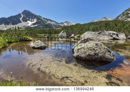 Reflection of Sivrya peak and Banski lakes, Pirin Mountain, Bulgaria