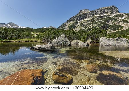 Reflection of Dzhangal peak and Banski lakes, Pirin Mountain, Bulgaria