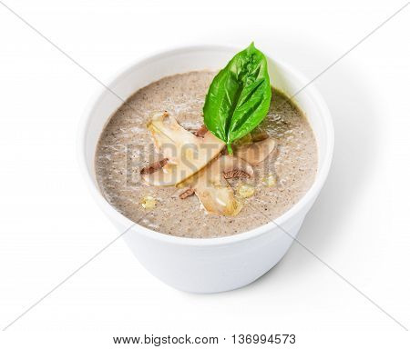 French cuisine hot food delivery - mushroom soup isolated closeup in white plastic plate