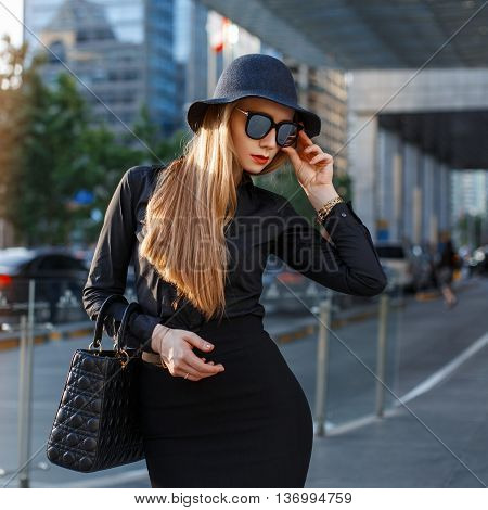 Successful Stylish Young Girl In Fashionable Clothes On A Background Of A Modern City.