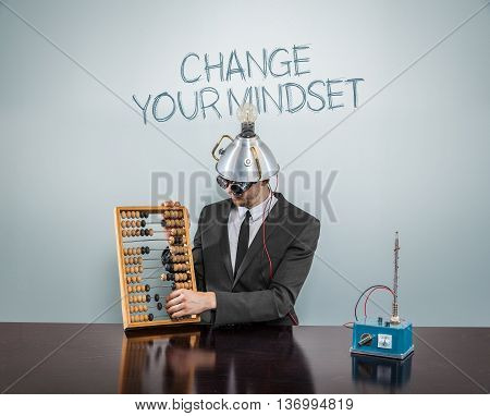 Change your mindset with businessman and abacus