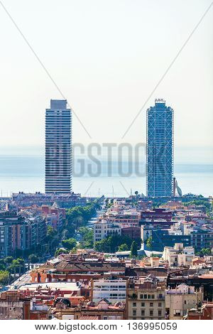 Barcelona Panorama with two high-rise skyscrapers and the sea on the horizon. Travel to Spain.