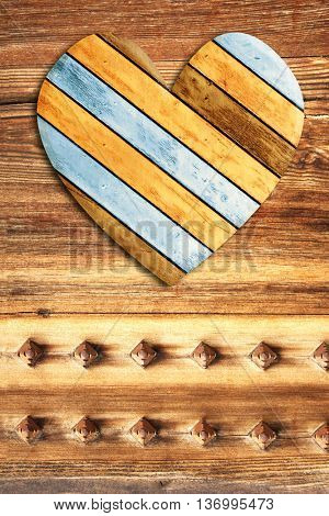 Wooden heart on old wood boards