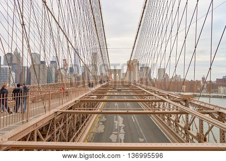 NEW YORK - CIRCA MARCH, 2016: view of the support structure over the Brooklyn Bridge roadway. The Brooklyn Bridge is connects the boroughs of Manhattan and Brooklyn by spanning the East River.