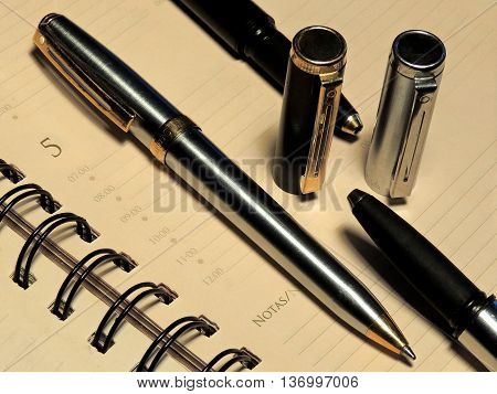 Notepad and pens as part of written communication.