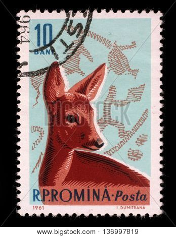 ZAGREB, CROATIA - JULY 18: stamp printed by Romania, show Roe Deer and Bronze Age Hunting Scene, circa 1961, on July 18, 2012, Zagreb, Croatia