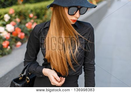 Stylish Young Girl In A Black Clothes And A Handbag.
