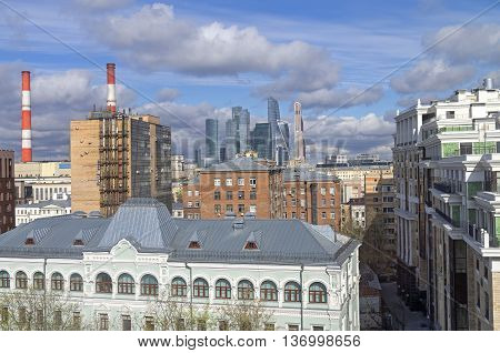View of the business center Moscow City. Mixing of various architectural styles in urban environment. Sunny day in mid-April. Moscow Russia.