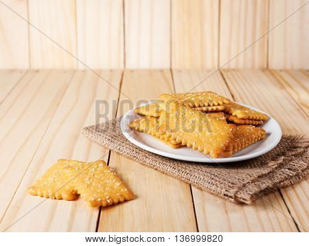 Stacked Butter Biscuits with sesame on wooden background