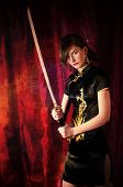 picture of bareback  - woman dressed like a Giesha and Katana swords in her hands - JPG
