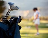 stock photo of golf bag  - Bag of golf clubs outdoors  - JPG