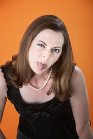 image of spoiled brat  - Bratty Caucasian woman sticks her tongue out - JPG