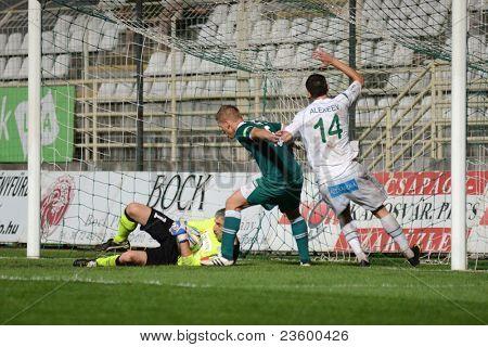 KAPOSVAR, HUNGARY - SEPTEMBER 10: Serghei Alexeev (in white) in action at a Hungarian National Championship soccer game - Kaposvar (white) vs Gyor (green) on September 10, 2011 in Kaposvar, Hungary.