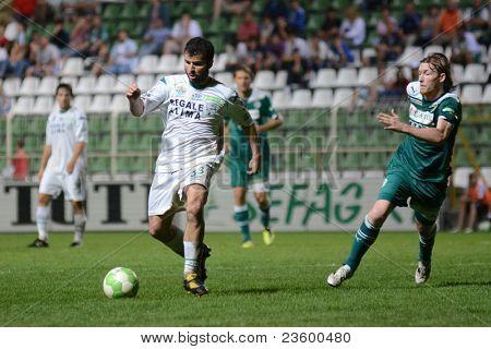 KAPOSVAR, HUNGARY - SEPTEMBER 10: Pedro Sass (C) in action at a Hungarian National Championship soccer game - Kaposvar (white) vs Gyor (green) on September 10, 2011 in Kaposvar, Hungary.