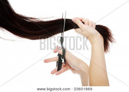 Scissors cutting hair