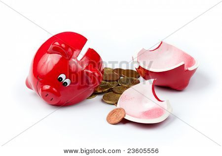 Broken piggy bank or money box with coins isolated on white