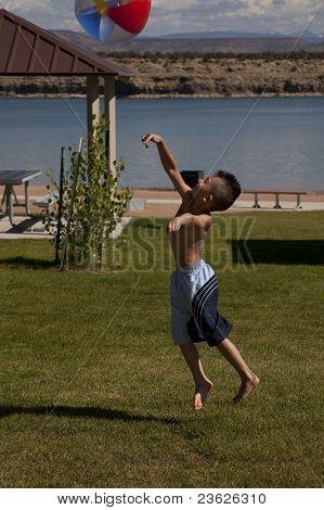 Boy Beach Ball Grass