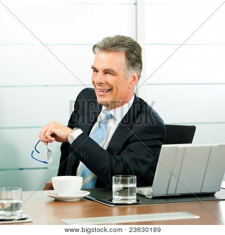 Senior Manager or boss in meeting discussing new strategy