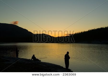 Trout Fishing In Norway On A Quiet Sunset