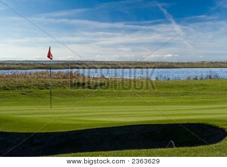 Golf Green And Bunker At Sea Shore
