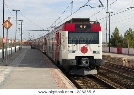 Passenger train arriving to station