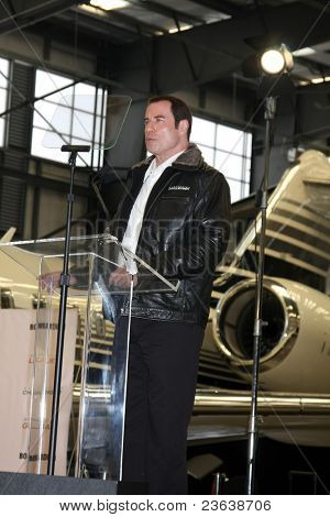 LOS ANGELES - SEP 20:  John Travolta at the Bombardier Aircraft Event announcing John Travolta as the Spokesperson for Bombardier at Hanger 25, Burbank Airport on September 20, 2011 in Burbank, CA