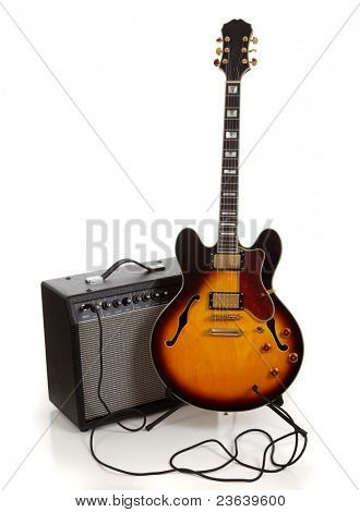 An electric guitar  and amplifier on a white background