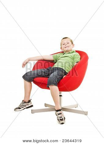Young Boy In An Armchair