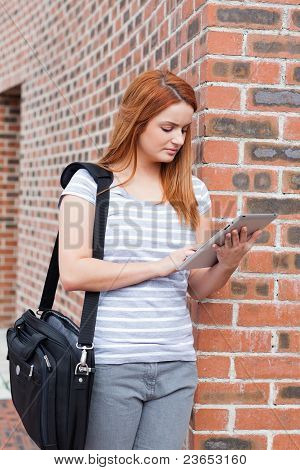 Portrait Of A Serious Student Working With A Tablet Computer