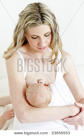 portrait of mother nursing her baby