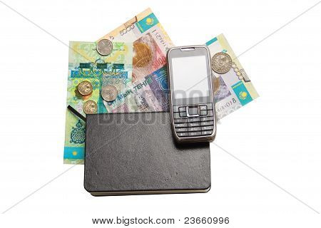 notebook and money over white with mobile phone