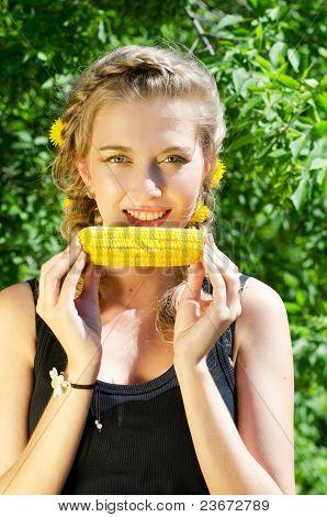 woman eating corn-cob