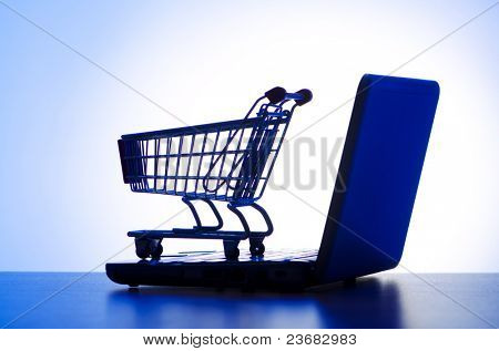 Silhoette of laptop and shopping cart
