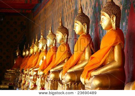 A Row Of Seated Buddhas At The Temple Of Wat Arun In Bangkok, Thailand